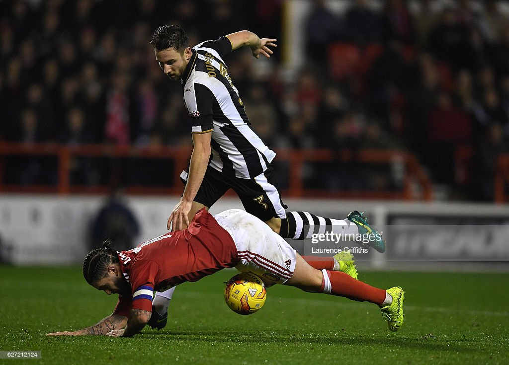 Henri Lansbury of Nottingham Forest is fouled by Paul Dummett of Newcastle United to give away a penalty during the Sky Bet Championship match between Nottingham Forest and Newcastle United at City Ground on December 2, 2016 in Nottingham, England.
