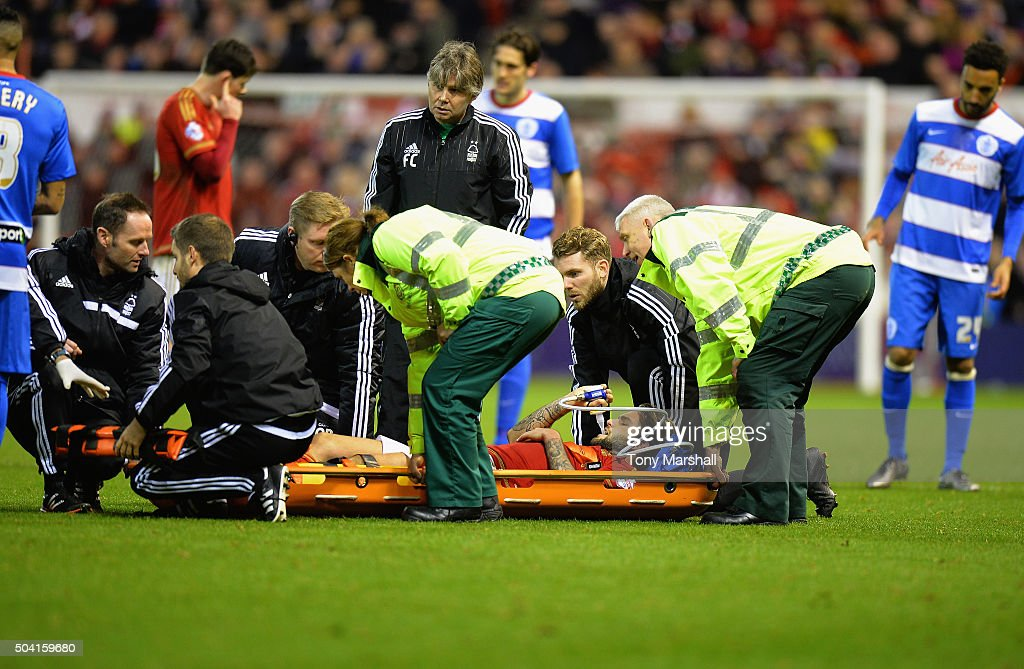 Henri Lansbury of Nottingham Forest is stretchered off after suffering an injury during The Emirates FA Cup Third Round match between Nottingham Forest and Queens Park Rangers at City Ground on January 9, 2016 in Nottingham, England.