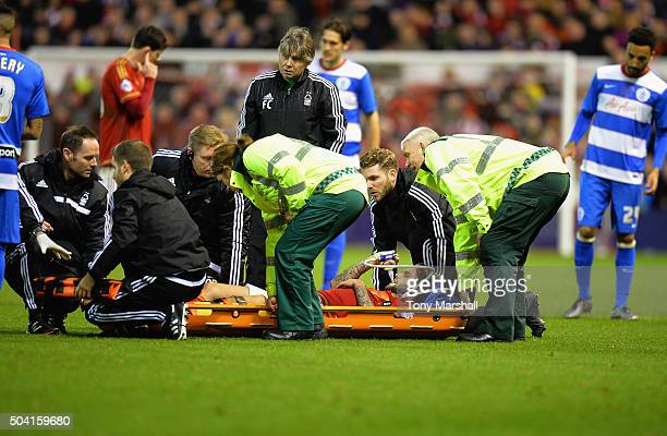 Henri Lansbury of Nottingham Forest is stretchered off after suffering an injury during The Emirates FA Cup Third Round match between Nottingham...