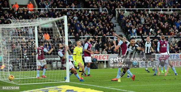 Henri Lansbury of Villa scores an own goal during the Sky Bet Championship match between Newcastle United and Aston Villa at St James' Park on...