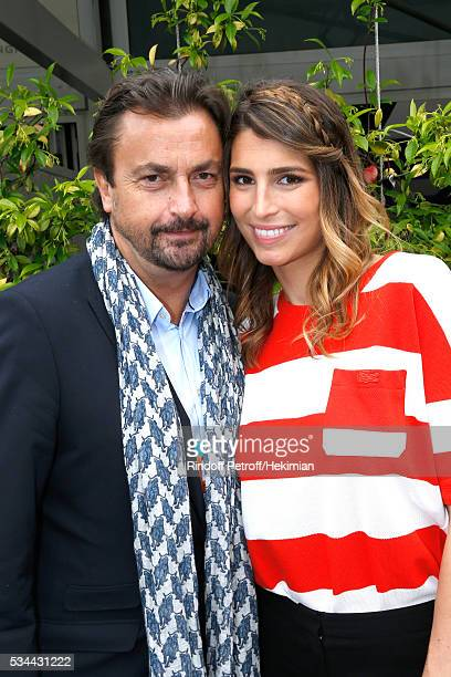 Henri Leconte and journalist Laury Thilleman attend the 2016 French Tennis Open Day Four at Roland Garros on May 25 2016 in Paris France