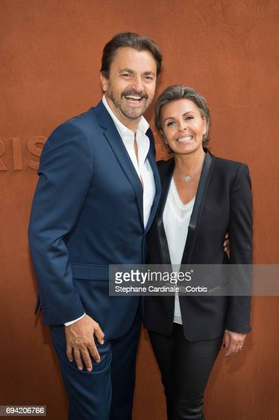 Henri Leconte and Maria Dowlatshahi attend the French Tennis Open 2017 Day Thirteen at Roland Garros on June 9 2017 in Paris France