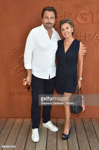 Henri Leconte and Maria Dowlatshahi attend the Men Final of the 2017 French Tennis Open Day Fifteen at Roland Garros on June 11 2017 in Paris France