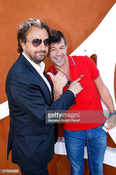 Henri Leconte and TV Host Stephane Plaza attend the 2015 Roland Garros French Tennis Open at Roland Garros on May 24 2015 in Paris France