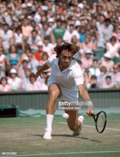 Henri Leconte in action against Boris Becker of Germany during their men's singles QuarterFinal match in the Wimbledon Lawn Tennis Championships at...