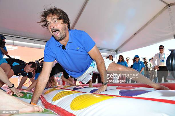 Henri Leconte of France during a game of giant inflatable twister on Grand Slam Oval during day 10 of the 2014 Australian Open at Melbourne Park on...