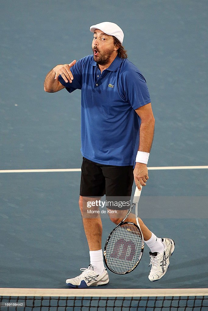 <a gi-track='captionPersonalityLinkClicked' href=/galleries/search?phrase=Henri+Leconte&family=editorial&specificpeople=159217 ng-click='$event.stopPropagation()'>Henri Leconte</a> of France reacts during the World Tennis Challenge at Memorial Drive on January 9, 2013 in Adelaide, Australia.