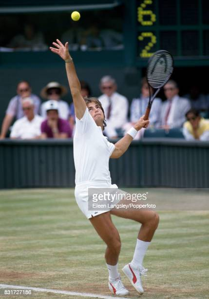 Henri Leconte of France serves during a men's singles match at the Wimbledon Lawn Tennis Championships in London circa July 1986 Leconte was defeated...