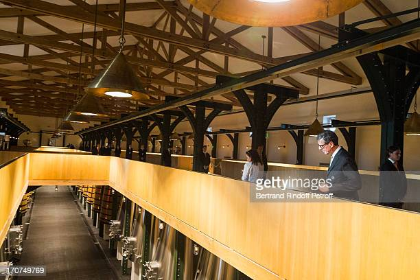 Henri Loyrette views the new vat room in the wine storehouse at Chateau Mouton Rothschild prior to the dinner of Conseil des Grand Crus Classes of...