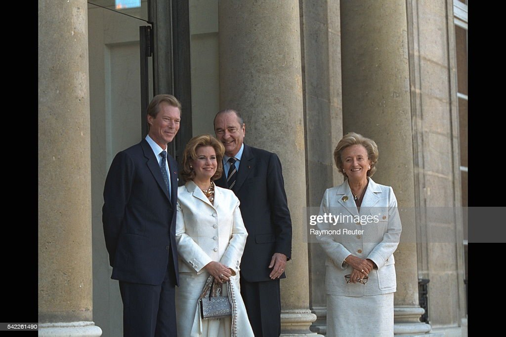 Henri of Luxembourg and Maria Teresa at the Elys{e Palace with Jacques and Bernadette Chirac who hosted a reception in honor of the Grand Duke and Grand Duchess.