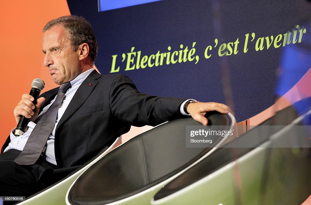 <a gi-track='captionPersonalityLinkClicked' href=/galleries/search?phrase=Henri+Proglio&family=editorial&specificpeople=569837 ng-click='$event.stopPropagation()'>Henri Proglio</a>, chairman of Electricite de France SA (EDF), holds a microphone and pauses as he speaks at the annual symposium of the Union Francaise de L'Electicite (UFE) in Paris, France, on Tuesday, June 17, 2014. Key speakers spoke at the event headlined as the Low Carbon Strategy and Industrial Renaissance; two challenges for the Energy Tranmsition. Photographer: Kosuke Okahara/Bloomberg via Getty Images