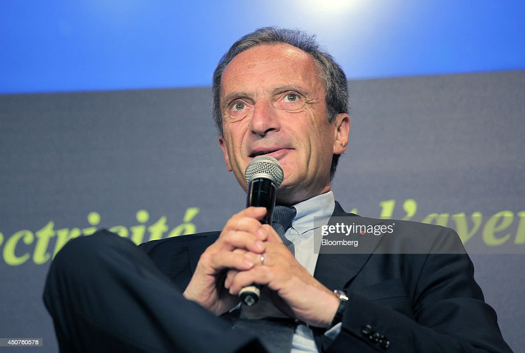 <a gi-track='captionPersonalityLinkClicked' href=/galleries/search?phrase=Henri+Proglio&family=editorial&specificpeople=569837 ng-click='$event.stopPropagation()'>Henri Proglio</a>, chairman of Electricite de France SA (EDF), holds a microphone as he speaks at the annual symposium of the Union Francaise de L'Electicite (UFE) in Paris, France, on Tuesday, June 17, 2014. Key speakers spoke at the event headlined as the Low Carbon Strategy and Industrial Renaissance; two challenges for the Energy Tranmsition. Photographer: Kosuke Okahara/Bloomberg via Getty Images