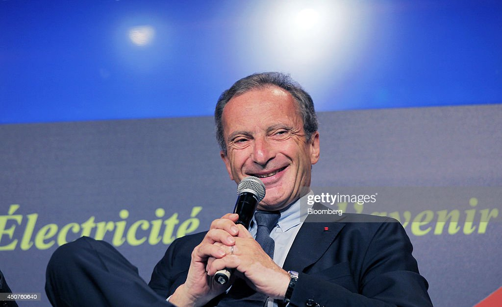 <a gi-track='captionPersonalityLinkClicked' href=/galleries/search?phrase=Henri+Proglio&family=editorial&specificpeople=569837 ng-click='$event.stopPropagation()'>Henri Proglio</a>, chairman of Electricite de France SA (EDF), reacts as holds a microphone while speaking at the annual symposium of the Union Francaise de L'Electicite (UFE) in Paris, France, on Tuesday, June 17, 2014. Key speakers spoke at the event headlined as the Low Carbon Strategy and Industrial Renaissance; two challenges for the Energy Tranmsition. Photographer: Kosuke Okahara/Bloomberg via Getty Images