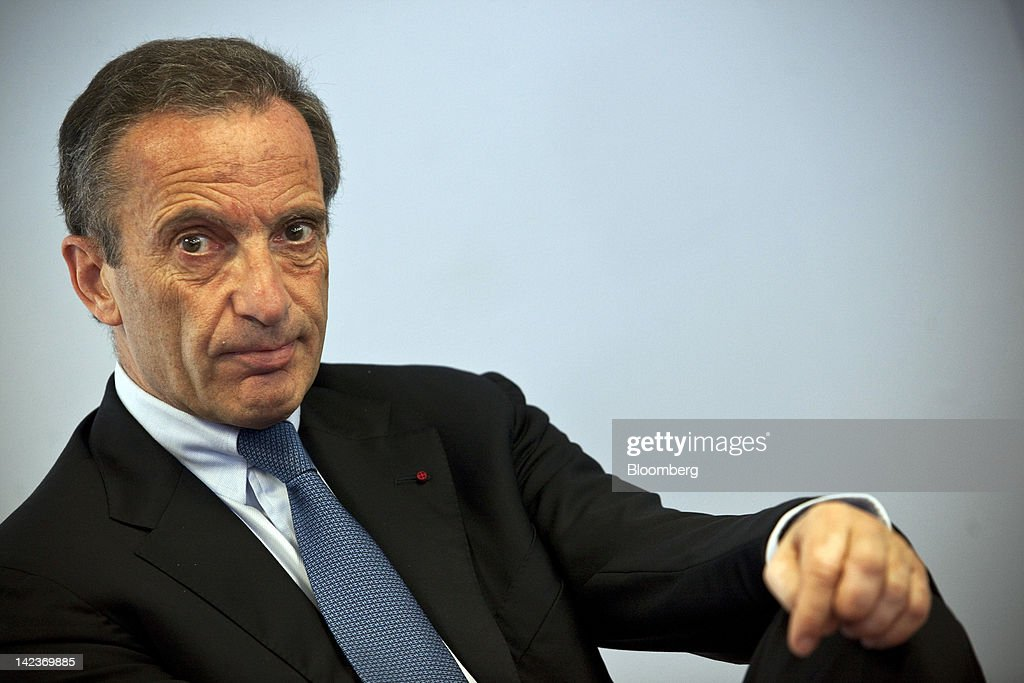 <a gi-track='captionPersonalityLinkClicked' href=/galleries/search?phrase=Henri+Proglio&family=editorial&specificpeople=569837 ng-click='$event.stopPropagation()'>Henri Proglio</a>, chief executive officer of Electricite de France SA (EDF), sits and listens during a news conference at the company's headquarters in Paris, France, on Tuesday, April 3, 2012. Electricite de France SA, the world's biggest operator of atomic plants, remains committed to developing nuclear reactors in the U.K. even after Germany's two biggest utilities abandoned projects in the country. Photographer: Balint Porneczi/Bloomberg via Getty Images