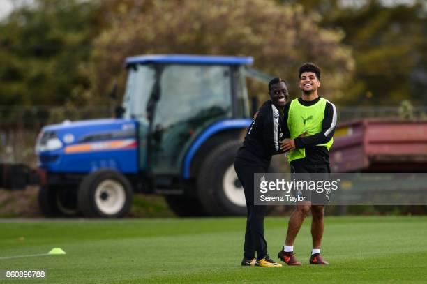 Henri Saivet and DeAndre Yedlin share a joke during the Newcastle United Training session at the Newcastle United Training Centre on October 13 in...