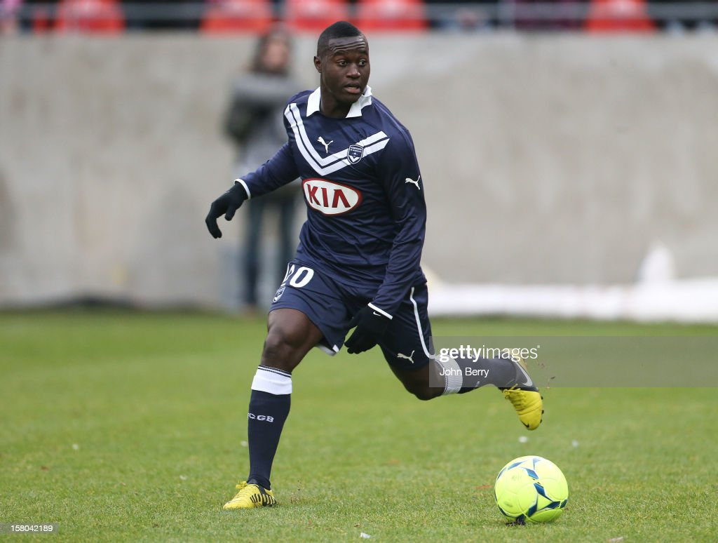 <a gi-track='captionPersonalityLinkClicked' href=/galleries/search?phrase=Henri+Saivet&family=editorial&specificpeople=5969966 ng-click='$event.stopPropagation()'>Henri Saivet</a> of Bordeaux in action during the French Ligue 1 match between Stade de Reims and Girondins de Bordeaux at the Stade Auguste Delaune on December 9, 2012 in Reims, France.