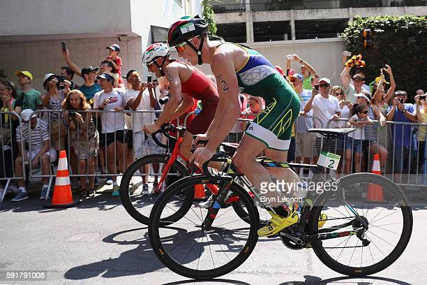 Henri Schoeman of South Africa and Andrea Salvisberg of Switzerland compete during the Men's Triathlon at Fort Copacabana on Day 13 of the 2016 Rio...