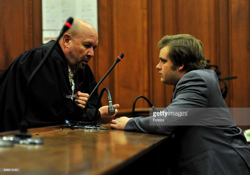 Henri van Breda along with advocate Pieter Botha seen in court on August 21, 2017 in Cape Town South Africa. Van Bredas funds for the court case is running out fast as the state asked for another postponement as their expert witness is still booked off due to illness, advocate Pieter Botha for Henri told the court that his client could not afford another postponement.