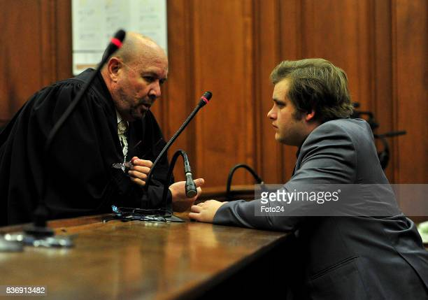 Henri van Breda along with advocate Pieter Botha seen in court on August 21 2017 in Cape Town South Africa Van Bredas funds for the court case is...