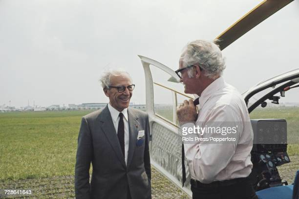 Henri Ziegler President and CEO of French aerospace manufacturer Aerospatiale pictured on left as he greets American businessman and United States...