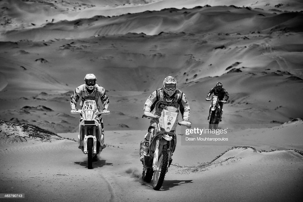 Henricus Vogels of the Netherlands for KTM Bas Dakar Team, (#52) Claudio Rodriguez of Chile for Tamarugal Honda Racing XC Rally Team and (#67) Robert Van Pelt from the Netherlands for Honda Team Van Pelt compete in stage 12 on the way to La Serena during Day 13 of the 2014 Dakar Rally on January 17, 2014 in El Salvador, Chile.