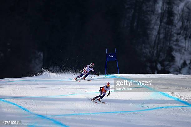 Henrieta Farkasova of Slovakia and guide Natalia Subrtova compete in the Women's Downhill Visually Impaired during day one of Sochi 2014 Paralympic...