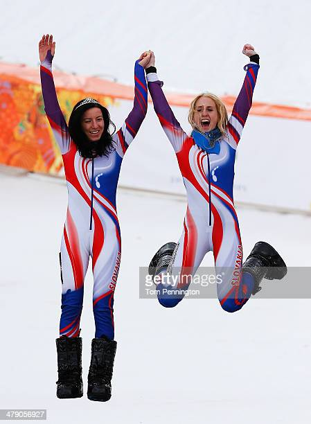 Henrieta Farkasova of Slovakia celebrates winning the gold medal with her guide Natalia Subrtova during the medal ceremony for the Women's Giant...