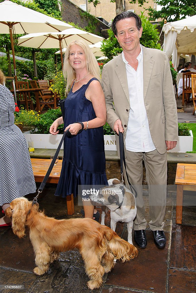 Henrietta O'Sullivan and Kevin O'Sullivan with Chaz and Dotty attend the Dogs Trust Honours 2013 at Home House on July 23, 2013 in London, England.