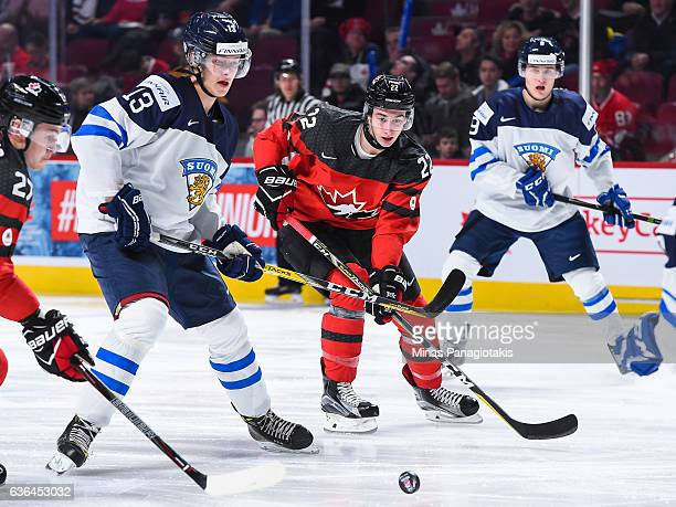 Henrik Borgstrom of Team Finland and Anthony Cirelli of Team Canada skate after the puck during the IIHF exhibition game at the Bell Centre on...