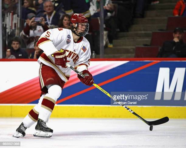 Henrik Borgstrom of the Denver Pioneers advances the puck against the Notre Dame Fighting Irish during game two of the 2017 NCAA Division I Men's...