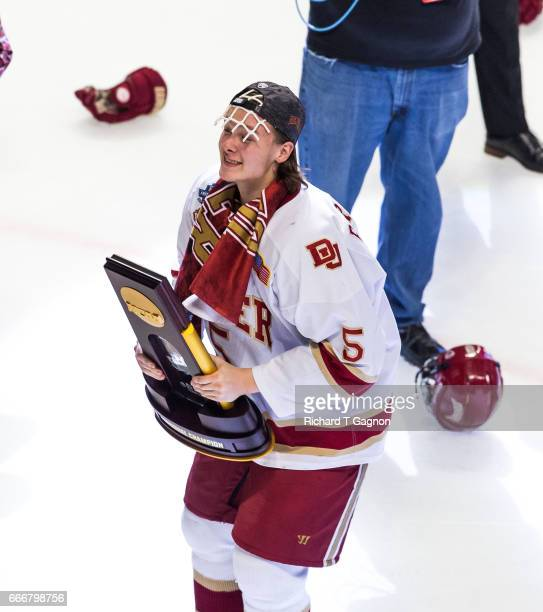 Henrik Borgstrom of the Denver Pioneers celebrates a victory against the Minnesota Duluth Bulldogs by holding the championship trophy after the 2017...