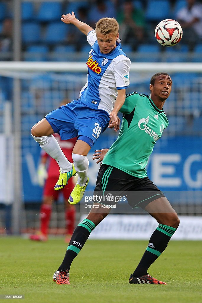 Henrik Gulden of Bochum and <a gi-track='captionPersonalityLinkClicked' href=/galleries/search?phrase=Joel+Matip&family=editorial&specificpeople=4462851 ng-click='$event.stopPropagation()'>Joel Matip</a> of Schalke go up for a header during the pre-season friendly match between VfL Bochum and FC Schalke 04 at Rewirpower Stadium on August 5, 2014 in Bochum, Germany.