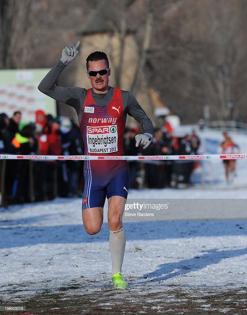Henrik Ingebrigsten of Norway celebrates as he crosses the finish line to win the U23 Men's race during the 19th SPAR European Cross Country Championships on December 9, 2012 in Budapest, Hungary.