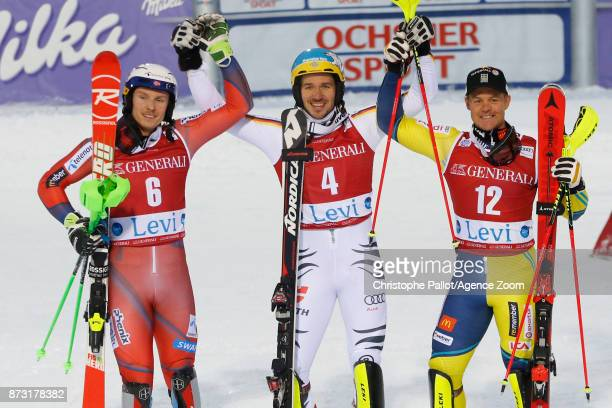 Henrik Kristoffersen of Norway takes 2nd place Felix Neureuther of Germany takes 1st place Mattias Hargin of Sweden takes 3rd place during the Audi...