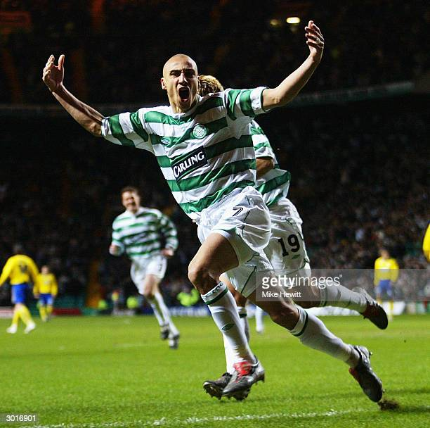 Henrik Larsson of Celtic celebrates with teammate Stilian Petrov after scoring during the UEFA Cup match between Celtic and FK Teplice at Celtic Park...