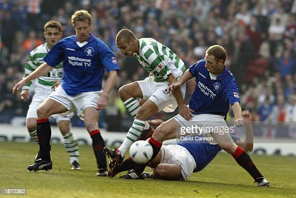 Henrik Larsson of Celtic is challenged by Craig Moore and Bert Konterman of Rangers during the CIS Insurance Cup Final match between Celtic and...