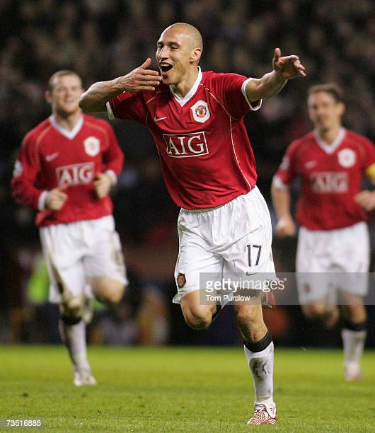 Henrik Larsson of Manchester United celebrates scoring the first goal during the UEFA Champions League Round of 16 second leg match between...