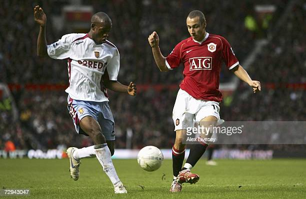 Henrik Larsson of Manchester United is pressurised by Isaiah Osbourne of Aston Villa during the FA Cup sponsored by EON Third Round match between...