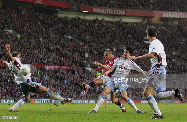 Henrik Larsson of Manchester United scores the first goal during the FA Cup sponsored by EON Third Round match between Manchester United and Aston...