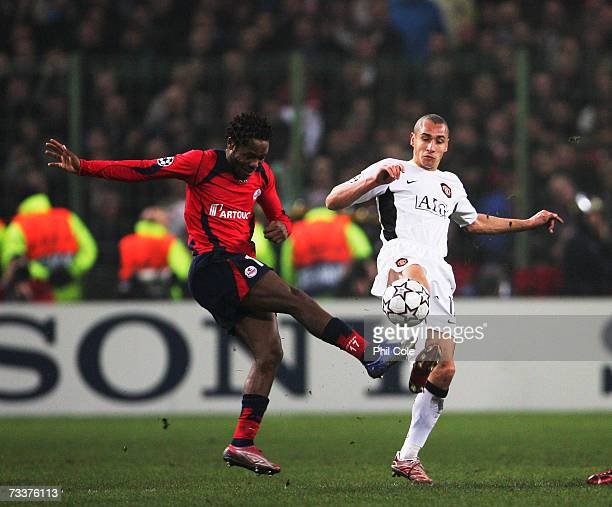 Henrik Larsson of Manchester United tackles Jean II Makoun of Lille during the Champions League Round of 16 first leg between Lille and Manchester...