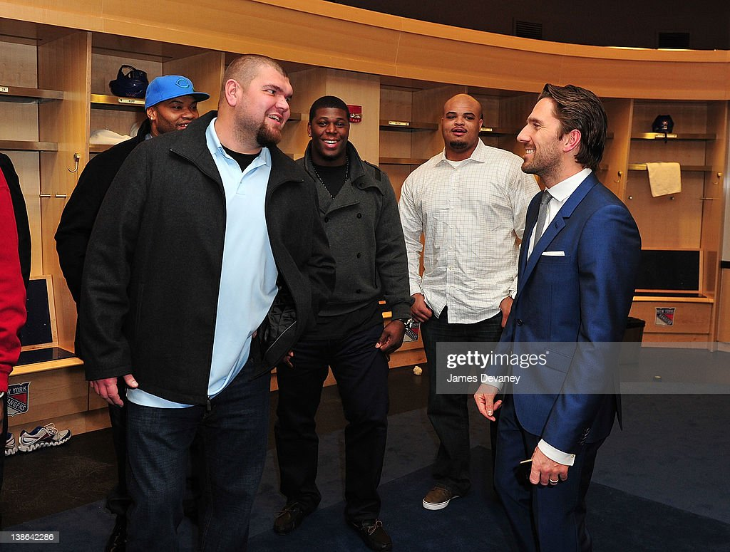 Henrik Linquist greets New York Giants players in the Rangers locker room after the Tampa Bay Lightning vs the New York Rangers game at Madison Square Garden on February 9, 2012 in New York City.