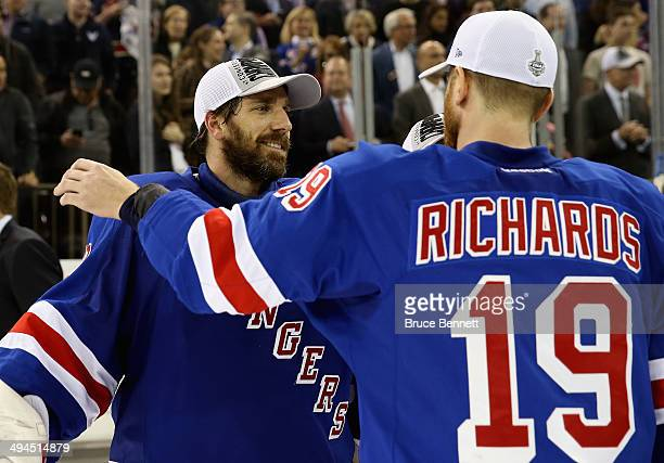 Henrik Lundqvist and Brad Richards of the New York Rangers celebrates after defeating the Montreal Canadiens in Game Six to win the Eastern...