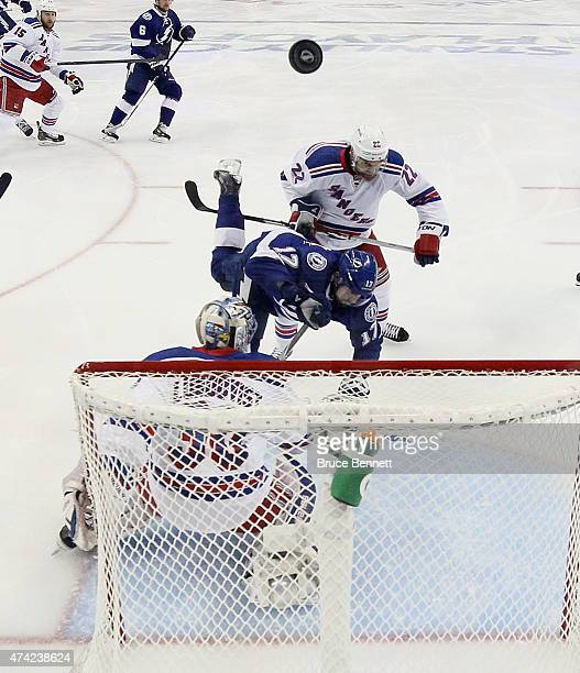 Henrik Lundqvist and Dan Boyle of the New York Rangers defend against Alex Killorn of the Tampa Bay Lightning in Game Three of the Eastern Conference...
