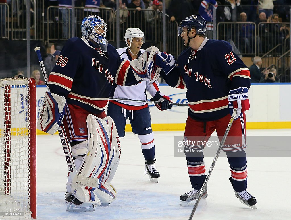 <a gi-track='captionPersonalityLinkClicked' href=/galleries/search?phrase=Henrik+Lundqvist&family=editorial&specificpeople=217958 ng-click='$event.stopPropagation()'>Henrik Lundqvist</a> #30 and <a gi-track='captionPersonalityLinkClicked' href=/galleries/search?phrase=Derek+Stepan&family=editorial&specificpeople=4687181 ng-click='$event.stopPropagation()'>Derek Stepan</a> #21 of the New York Rangers celebrate their 2-1 victory over the Washington Capitals at Madison Square Garden on February 17, 2013 in New York City.