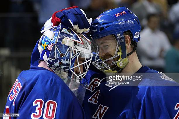 Henrik Lundqvist and Derek Stepan of the New York Rangers celebrate following their 21 victory over the Los Angeles Kings during Game Four of the...