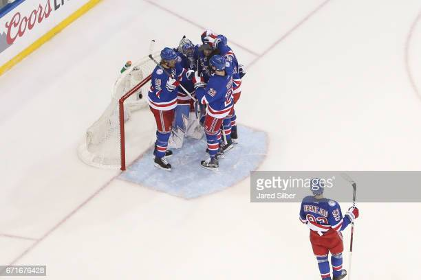Henrik Lundqvist and members of the New York Rangers celebrate after defeating the Montreal Canadiens 31 in Game Six of the Eastern Conference First...