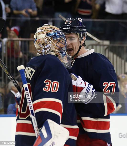 Henrik Lundqvist and Ryan McDonagh of the New York Rangers celebrate their 10 shutout against the Detroit Red Wings at Madison Square Garden on...