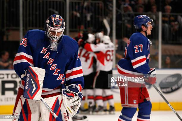 Henrik Lundqvist and Ryan McDonagh of the New York Rangers react as the Ottawa Senators celebrate after Jason Spezza scored a goal in the first...