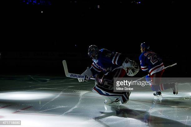 Henrik Lundqvist and Ryan McDonagh of the New York Rangers take to the ice prior to the game against the Washington Capitals in Game One of the...