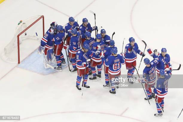 Henrik Lundqvist and the New York Rangers celebrate after defeating the Montreal Canadiens 31 in Game Six of the Eastern Conference First Round...